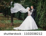 a stylish bridegroom in a black ... | Shutterstock . vector #1102038212