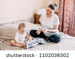 pregnant mom and her toddler... | Shutterstock . vector #1102038302