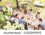 family celebration or a garden... | Shutterstock . vector #1102045952