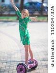 adorable little girl riding on...   Shutterstock . vector #1102047326