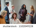 businessmen and women meeting... | Shutterstock . vector #1102049228