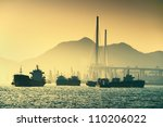 ship and sunset in the ocean - stock photo