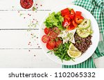 vegetarian buddha bowl with... | Shutterstock . vector #1102065332