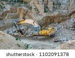 mining in the granite quarry.... | Shutterstock . vector #1102091378