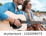 handsome man playing acoustic... | Shutterstock . vector #1102098575