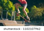 skateboarder skateboarding on... | Shutterstock . vector #1102107962