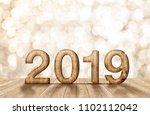 2019 happy year wood number in... | Shutterstock . vector #1102112042