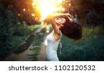 happy woman enjoying nature at... | Shutterstock . vector #1102120532