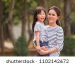 close up happy little girl face ... | Shutterstock . vector #1102142672