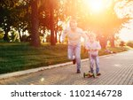 boy scooter father in park ... | Shutterstock . vector #1102146728