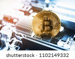 gold bitcoin electronic... | Shutterstock . vector #1102149332