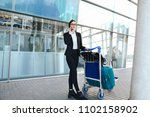 airport woman on smart phone at ... | Shutterstock . vector #1102158902