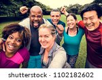 group of cheerful diverse... | Shutterstock . vector #1102182602