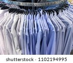 cloth hangers with shirts. men... | Shutterstock . vector #1102194995