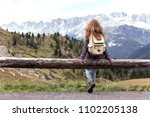 girl hiker sitting  and looking ...   Shutterstock . vector #1102205138