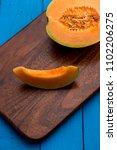 freshly cut muskmelon slice on... | Shutterstock . vector #1102206275