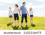 family of four outdoors in a... | Shutterstock . vector #1102216475