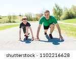 father with son sport running... | Shutterstock . vector #1102216628