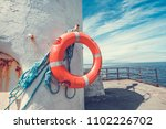 orange lifebuoy hanged on the... | Shutterstock . vector #1102226702