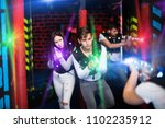 young couple playing laser tag... | Shutterstock . vector #1102235912