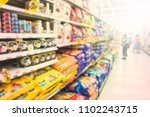 Stock photo blurred various brand of food pet in packaging for sale on supermarket stand or shelf 1102243715