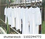white t shirt hanging outdoor  ... | Shutterstock . vector #1102294772