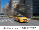 yellow taxi cab driving quickly ... | Shutterstock . vector #1102373912
