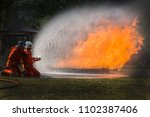 Small photo of Firefighters in situations, Firefighters training, Team practice to fighting with fire in emergency situation. Spray water to the flame