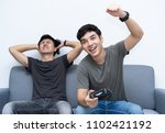 friends and video games. two...   Shutterstock . vector #1102421192