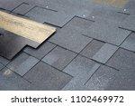 installing asphalt roofing...   Shutterstock . vector #1102469972