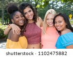 group of young female friends... | Shutterstock . vector #1102475882