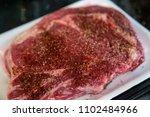 raw seasoned steak on styrofoam ... | Shutterstock . vector #1102484966