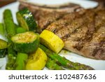 grilled t bone steak cooked on... | Shutterstock . vector #1102487636