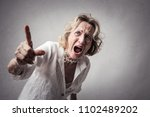 angry lady shouting | Shutterstock . vector #1102489202