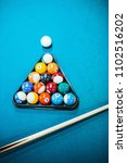 pool table with cue and rack of ... | Shutterstock . vector #1102516202
