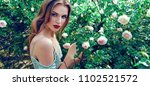 a beautiful young girl with... | Shutterstock . vector #1102521572