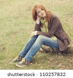 Beautiful girl at outdoor in autumn time. - stock photo