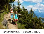 children hiking in alps... | Shutterstock . vector #1102584872