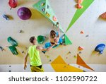 rock climbers in climbing gym.... | Shutterstock . vector #1102590722