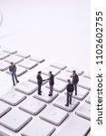 miniature dolls on the keyboard ... | Shutterstock . vector #1102602755