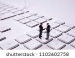 miniature dolls on the keyboard ... | Shutterstock . vector #1102602758