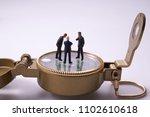 compass and miniature dolls  ... | Shutterstock . vector #1102610618