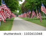 Rows Of American Flags Set Out...