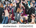 Small photo of Atlanta, GA / USA - April 8, 2018: Dozens of people extend legs and feet into the air as they take part in a massive group yoga class in Piedmont Park on April 8, 2018 in Atlanta, GA.