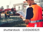site engineer at a construction ... | Shutterstock . vector #1102630325