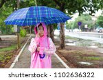 asian girl  with umbrella and...   Shutterstock . vector #1102636322