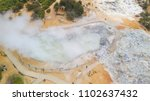 Small photo of Aerial view of tourism site Sikidang Crater, Dieng Plateau, Indonesia. It still active and explosive. It generates sulfur gas. There are some other craters aorund it utilized as steam power plant.