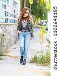 beautiful young woman wearing... | Shutterstock . vector #1102641185