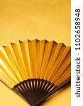 japanese golden folding fan    ... | Shutterstock . vector #1102658948