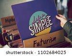 digging in a vintage vinyl... | Shutterstock . vector #1102684025